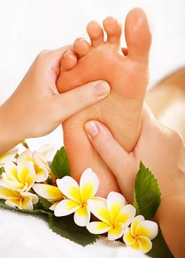 A picture of a foot being massaged.