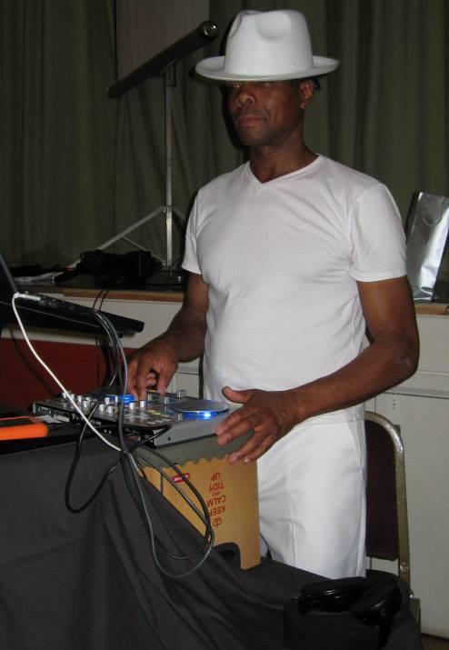 Leroy all in white in full DJ flow.