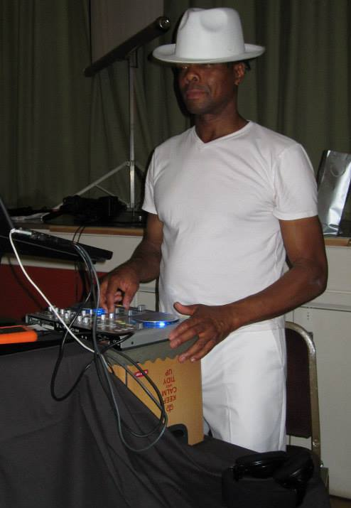 Leroy all in white in full DJ flow.